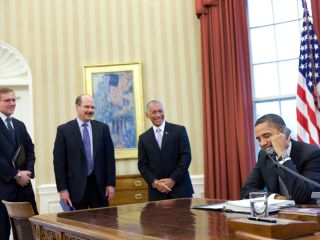 President Barack Obama makes a phone call with the crew of the Space Shuttle Discovery and the International Space Station from the Oval Office, March 3, 2011.