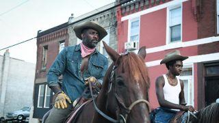 Idris Elba and Caleb McLaughlin in Concrete Cowboy