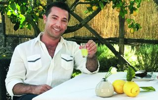 Gino D'Acampo continues his glorious journey along Italy's coastline, and his first stop is the super-chic island of Capri. Arriving by speedboat, of course, he discovers the story of Italy's famous after-dinner drink limoncello.
