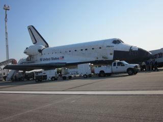 Atlantis Surrounded by Support Vehicles