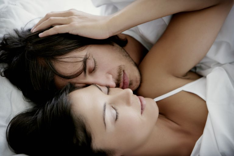 sex positions for menstrual cramps - Couple cuddling in bed