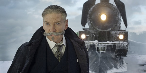 Hercule Poirot stands in front of the train in Murder on the Orient Express.