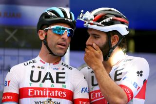 Argentinian road race champion Max Richeze receives a word in his ear from UAE Team Emirates teammate Fernando Gaviria ahead of stage 4 of the 2020 Vuelta a San Juan