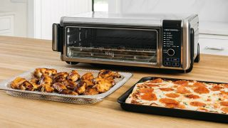 The Ninja Foodi Digital Air Fry Oven SP101 is $50 off, but it's selling out fast