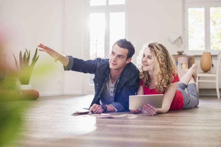 house prices: couple browsing online