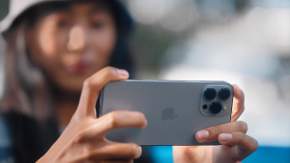 iPhone 13 Pro user taking a photo