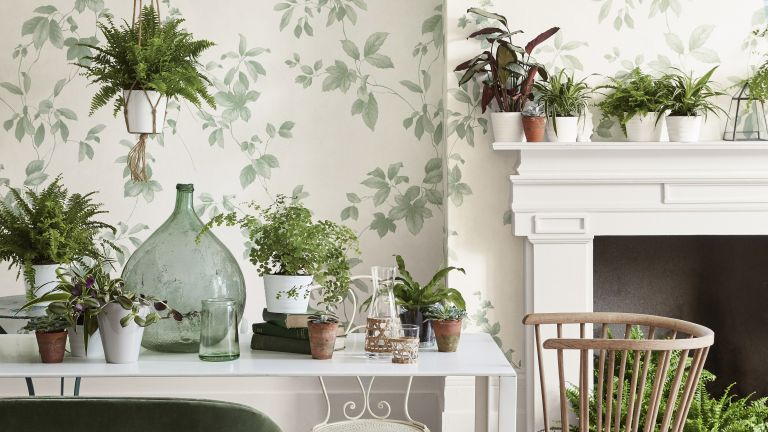 Floral wallpaper in a dining room by Little Greene