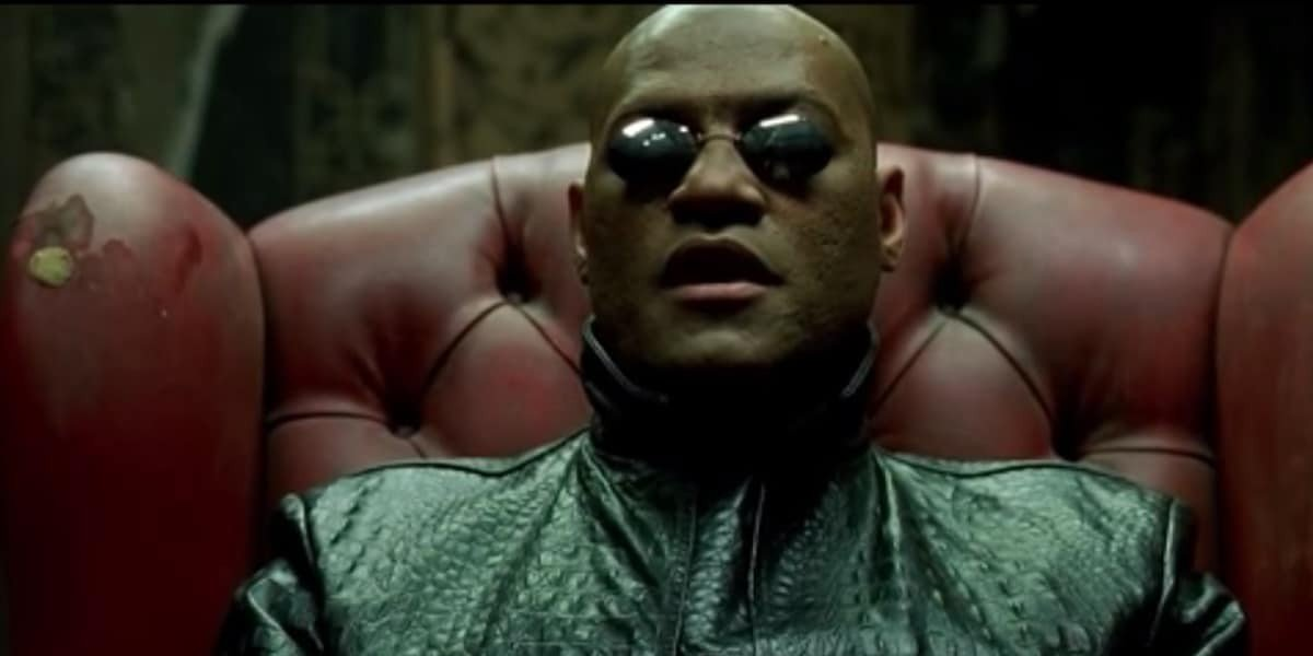 Laurence Fishburne sitting in a chair