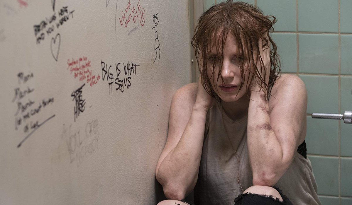 IT Chapter Two Jessica Chastain huddled, hands over her ears, in a bathroom stall