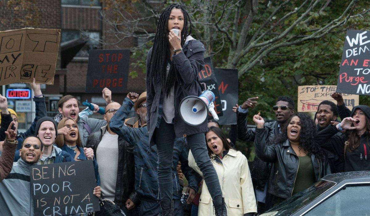 Lex Scott Davis leads a protest against The First Purge.