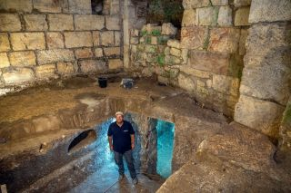 Co-director of the excavation Barak Monnickendam-Givon standing in the subterranean chambers.