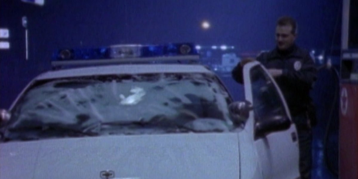 A police officer reacts to the goo on his windshield on Unsolved Mysteries