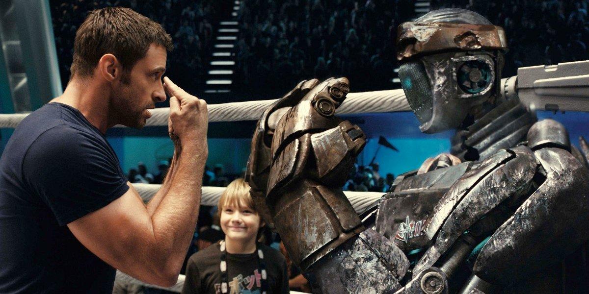 Hugh Jackman locks eyes with Atom in the ring in Real Steel.