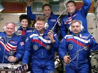 NASA astronaut Scott Kelly (bottom left) and Russian cosmonauts Gennady Padalka (bottom center) and Mikhail Kornienko (bottom right) are seen on the International Space Station after arriving at the outpost on March 27, 2015. Kelly and Kornienko are begi