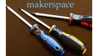 """Three screwdrivers with brightly colored handles labeled """"kids at work"""""""