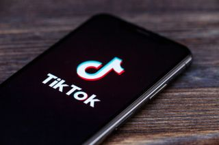 TikTok logo displayed on an iPhone.