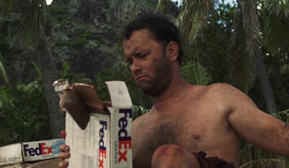 Cast Away Tom Hanks looking through FedEx boxes