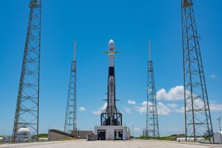A SpaceX Falcon 9 rocket topped with 60 Starlink internet satellites on the pad at Florida's Cape Canaveral Air Force Station in May 2019.