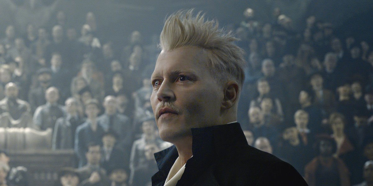 "Gellert Grindelwald (Johnny Depp) stands before a crowd in ""Fantastic Beasts and Where To Find Them: The Crimes of Grindelwald'"