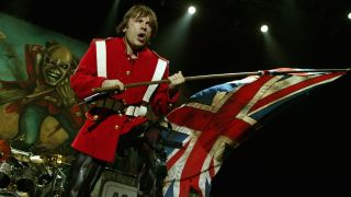 Bruce Dickinson onstage with a British flag