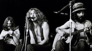 A photograph of Led Zeppelin on stage playing an acoustic set in 1972