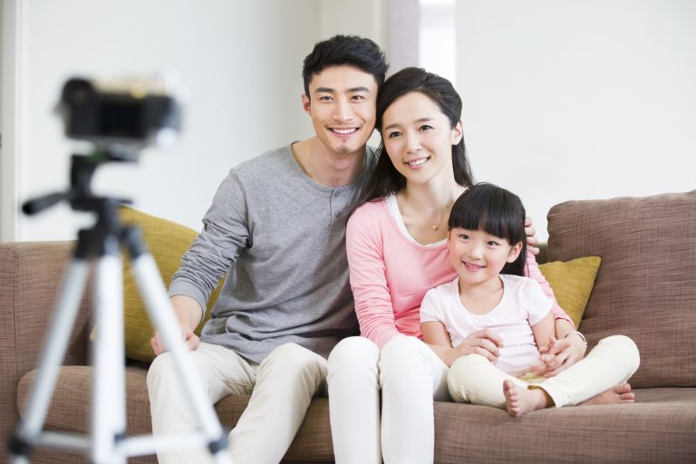 family taking photo with a tripod