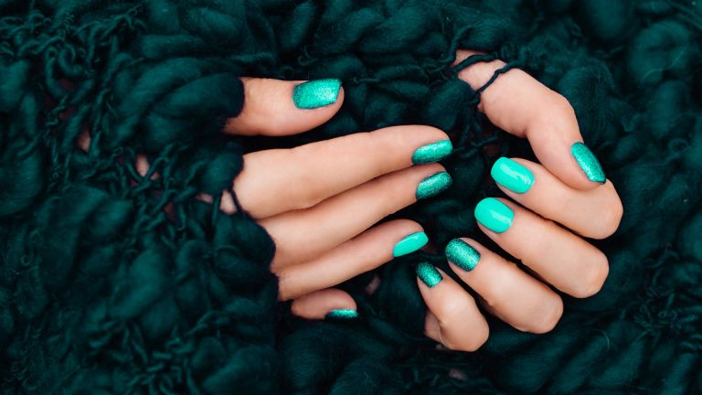 nails painted green with green background