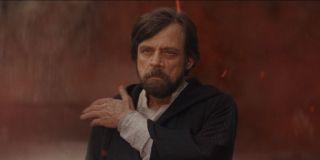 Luke Skywalker, brushing off dust in Star Wars: The Last Jedi