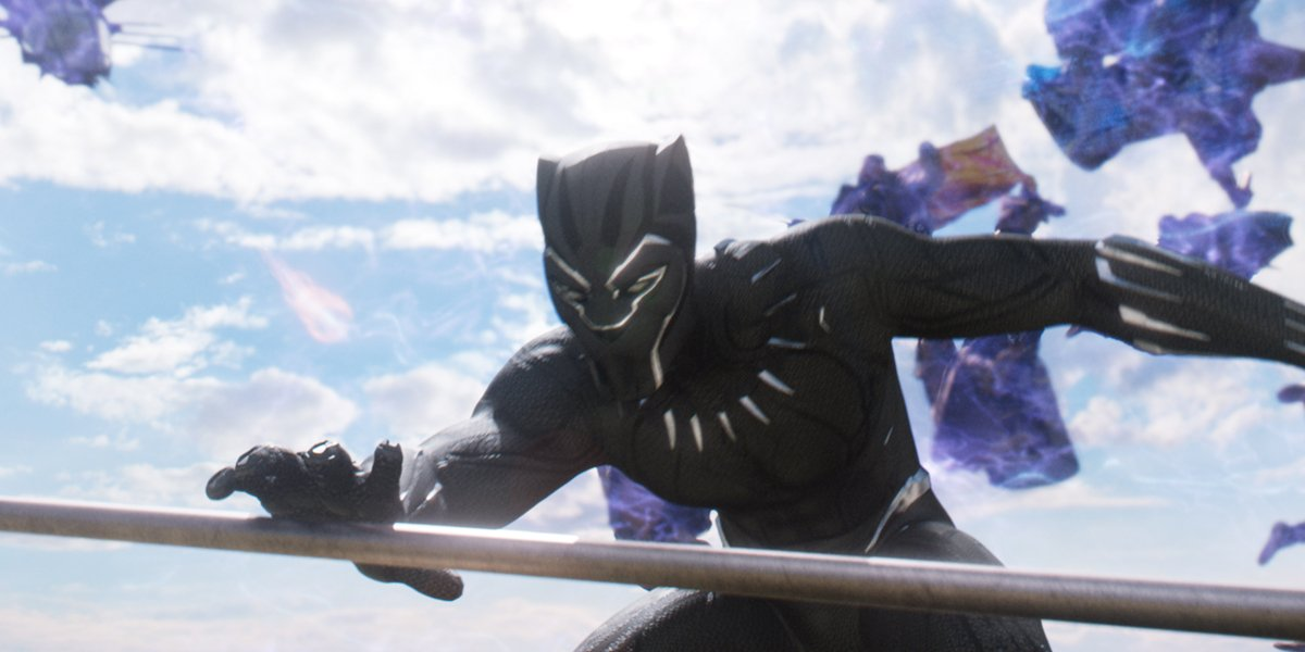 Black Panther grabbing a spear in battle in Black Panther