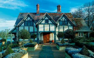traditional oak frame home exterior in winter