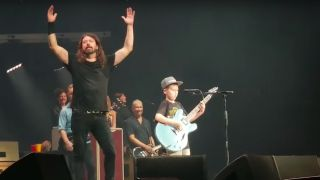 Dave Grohl gifted Collier Cash Rule one of his guitars at the end of the performance.