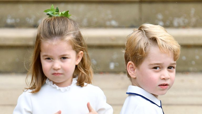 Princess Charlotte of Cambridge and Prince George of Cambridge attend the wedding of Princess Eugenie of York and Jack Brooksbank at St George's Chapel on October 12, 2018 in Windsor, England