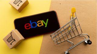 eBay logo next to shopping cart and boxes