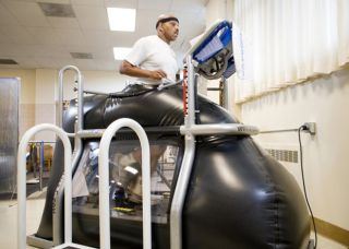 "Retired Staff Sgt. Jesse Whitmier exercises in the NASA-developed ""anti-gravity"" treadmill that allows him to control the amount of his body used during the workout."