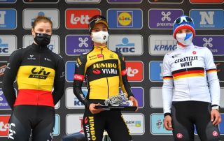 WEVELGEM BELGIUM MARCH 28 Podium Lotte Kopecky of Belgium and Team Liv Racing Marianne Vos of Netherlands and Team Jumbo Visma Lisa Brennauer of Germany and Ceratizit WNT Pro Cycling Team Celebration during the 10th GentWevelgem In Flanders Fields 2021 Womens Elite a 1417km race from Ypres to Wevelgem Mask Covid Safety Measures Trophy GWE21 GWEWomen FlandersClassic UCIWWT on March 28 2021 in Wevelgem Belgium Photo by Luc ClaessenGetty Images
