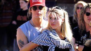 Jani Lane and Bobbie Brown in 1989