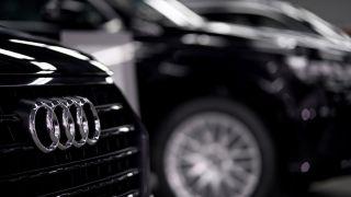 Several Audi vehicles lined up at a dealership.
