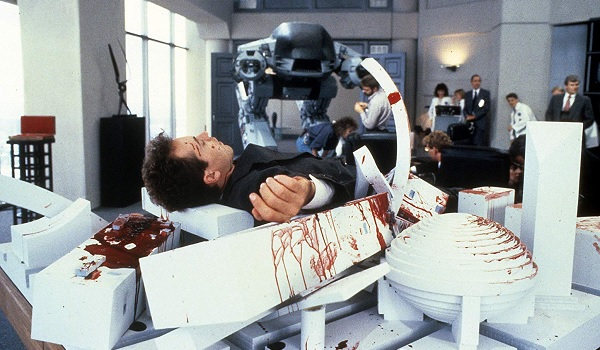 Robocop ED-209's bloody victim collapsed on a model