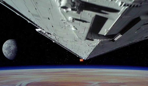 The Imperial Star Destroyer attacks a Rebel ship at the beginning of Star Wars