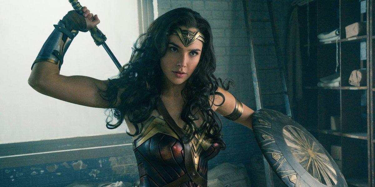 Gal Gadot as Wonder Woman holding sword