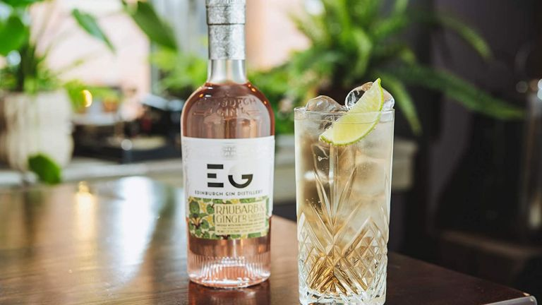 Gin deals: Edinburgh Gin Rhubarb and Ginger Pink Gin Liqueur bottle next to drink