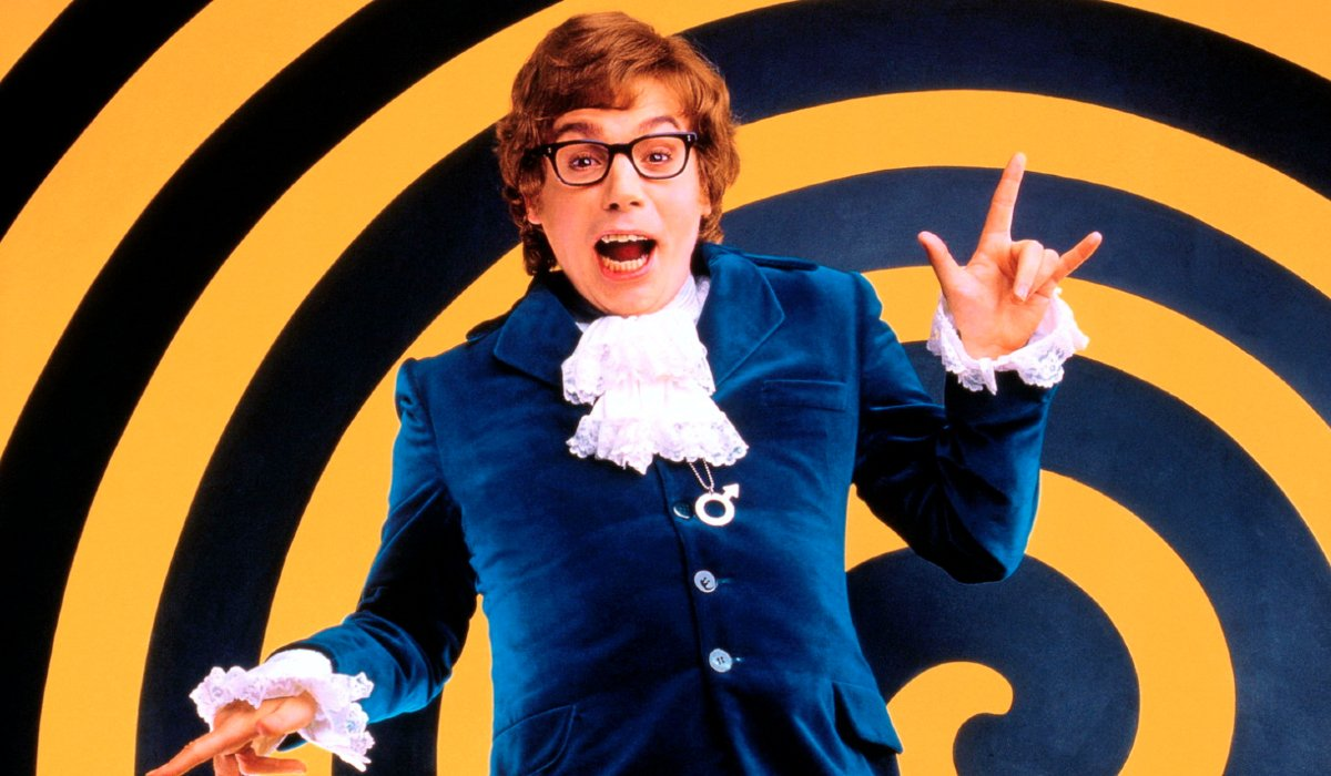 Austin Powers joyfully smiling in front of a spiral
