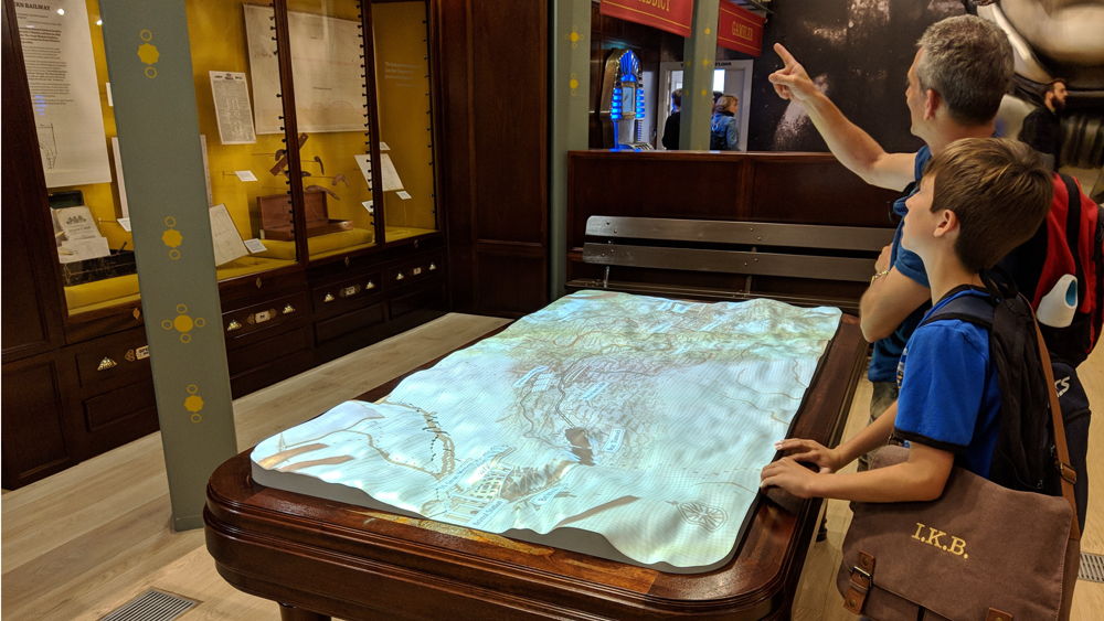 Visitors to the SS Great Britain museum looking at a 3D-printed map