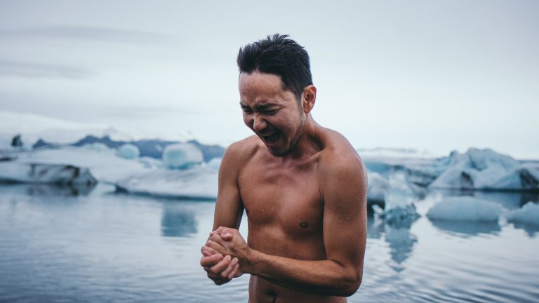 Man drying off after a cold ice bath and swim
