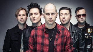 A studio portrait of Avenged Sevenfold looking into the camera