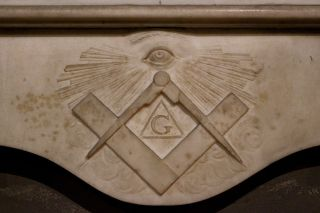 The square and compass symbol of the Freemasons.