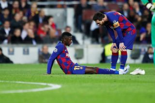 Ousmane Dembele and Lionel Messi