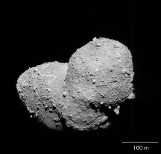 Asteroid Itokawa takes center stage in this photo from the Japan Aerospace Exploration Agency's Hayabusa spacecraft taken in October 2005. An analysis of samples collected by Hayabusa have revealed the origins of Itokawa, scientists say.