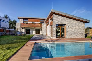 a self build home with a stone cladding exterior