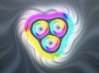 This image comes from a computer simulation of a skyrmion bag containing three skyrmions. White represents magnetic field lines pointing up, black represents lines pointing down, and other colors represent other directions.